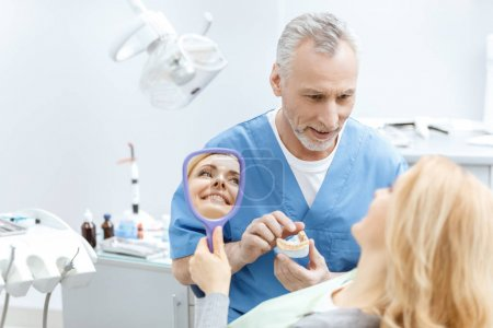 Dentist showing jaws model