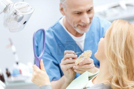 Dentist matching teeth colour