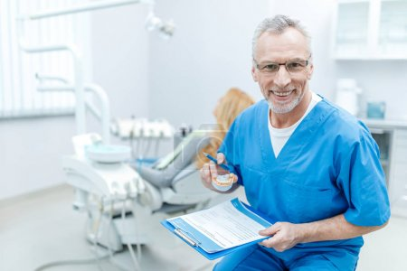 senior dentist in uniform
