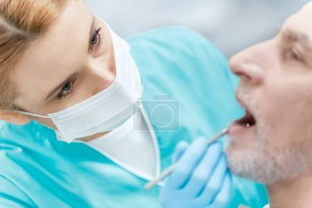 Dentist and patient in clinic