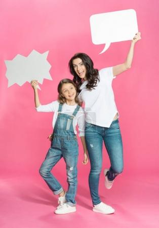 Mother and daughter with speech bubbles