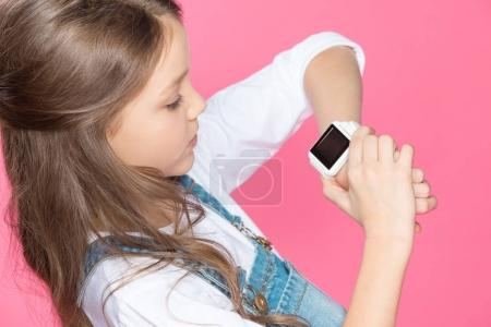 Little girl with smartwatch