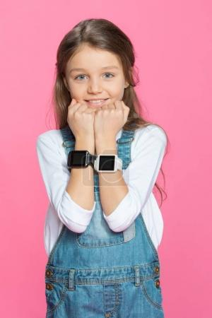 Little girl with smartwatches