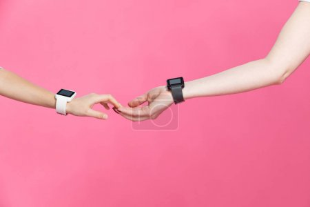 Mother and daughter with smartwatches