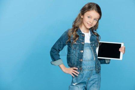 Girl holding digital tablet
