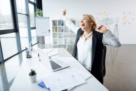 Yawning businesswoman at workplace