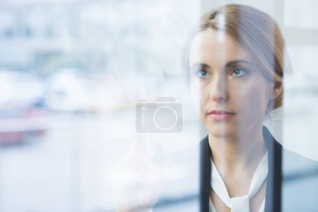 Pensive blonde businesswoman