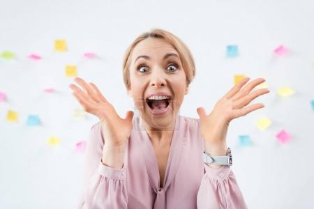 Photo for Portrait of excited blonde businesswoman with stickers behind - Royalty Free Image