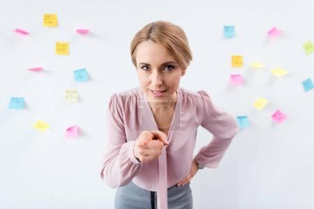 pointing blonde businesswoman