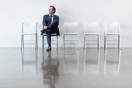 businessman sitting on chair