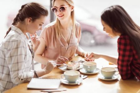 girls eating cake and drinking coffee