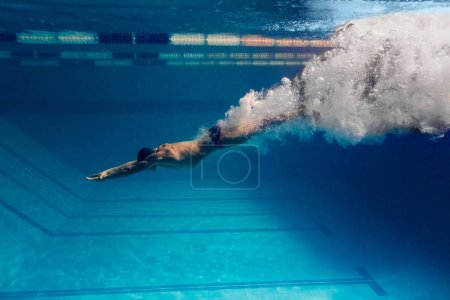 Photo for Underwater picture of male swimmer swimming i swimming pool - Royalty Free Image