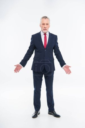 Confused mature businessman