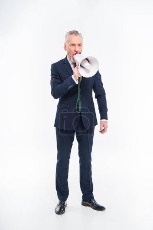 Geschäftsmann brüllt in Lautsprecher