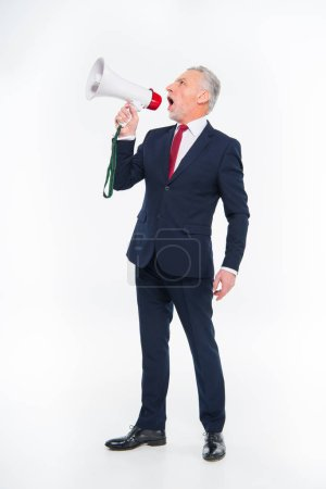 Businessman shouting in loudspeaker