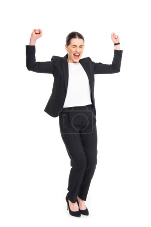 Photo for Cheerful businesswoman triumphing with raised fists and closed eyes isolated on white - Royalty Free Image