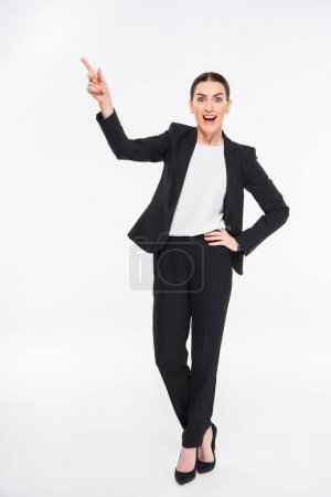 Surprised businesswoman pointing