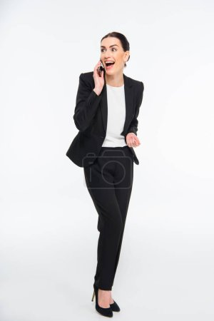 Photo for Excited professional businesswoman talking on smartphone isolated on white - Royalty Free Image