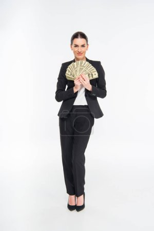 Businesswoman holding dollar banknotes