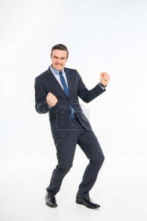 Photo for Cheerful businessman triumphing and looking at camera isolated on white - Royalty Free Image