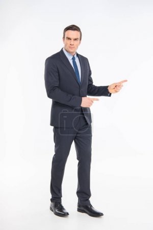 Professional businessman pointing