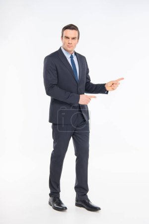 Foto de Professional businessman pointing with fingers and looking at camera isolated on white - Imagen libre de derechos