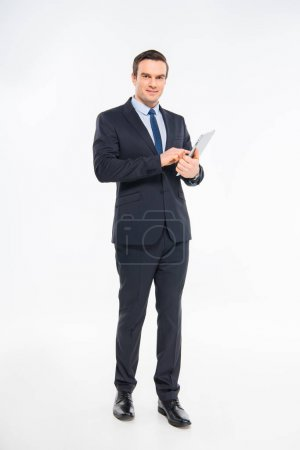 Photo for Professional young businessman using digital tablet isolated on white - Royalty Free Image