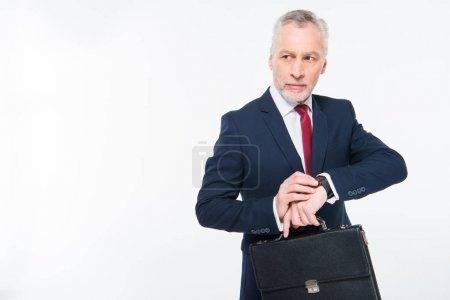 Businessman checking smartwatch