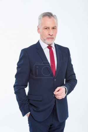 Photo for Handsome mature businessman with hand in pocket looking at camera isolated on white - Royalty Free Image