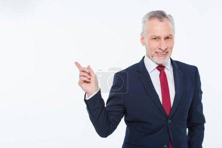 Photo for Handsome mature businessman pointing with finger at copy space isolated on white - Royalty Free Image
