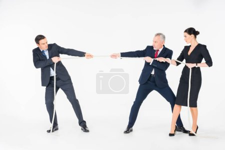 Photo for Three concentrated businesspeople pulling rope isolated on white - Royalty Free Image