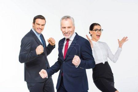 Three happy business people
