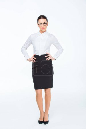 Photo pour Confident young businesswoman in glasses looking at camera isolated on white - image libre de droit