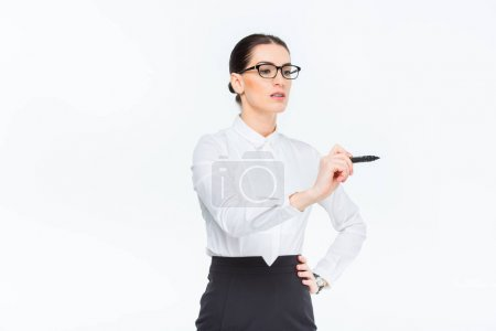 Businesswoman writing with marker