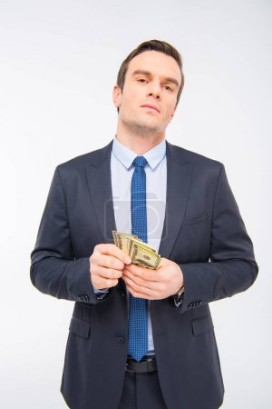 Young businessman with money