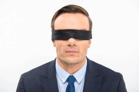 Young businessman in blindfold