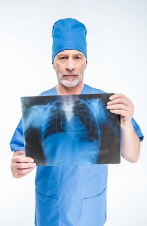 Photo for Portrait of mature male doctor holding x-ray image and looking at camera isolated on white - Royalty Free Image