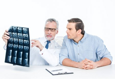 Doctor shows x-ray image