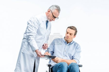 Handicapped man and doctor