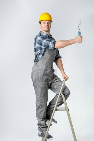 Workman with paint roller