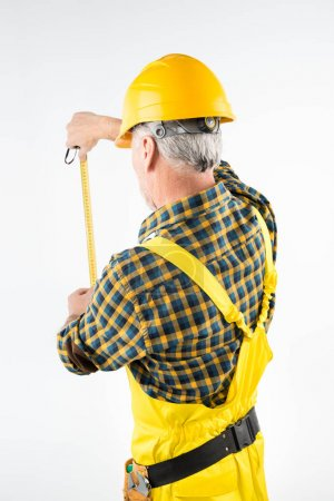 Mature workman in hard hat