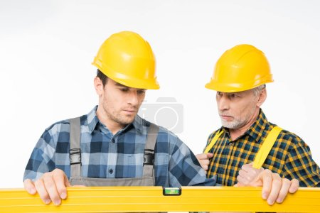 Workmen with level tool