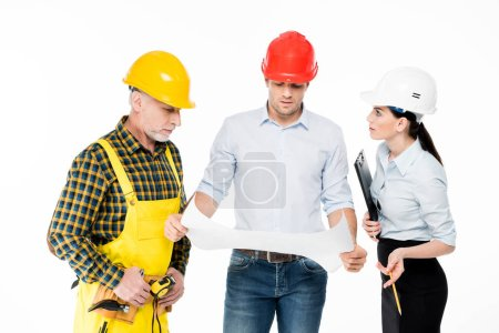 Two architects and workman
