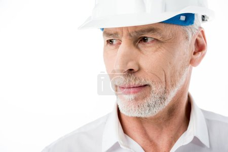 Foto de Close-up poartrait of mature male architect in hard hat isolated on white - Imagen libre de derechos