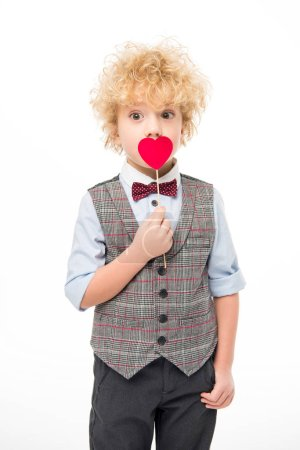 Boy holding red heart