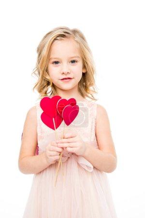 Photo pour Belle fille blonde en robe rose tenant des coeurs rouges sur des bâtons isolés sur blanc - image libre de droit