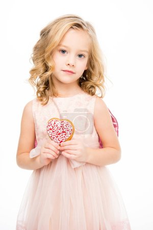 Photo for Adorable little girl in pink dress holding heart shaped cookie  isolated on white - Royalty Free Image