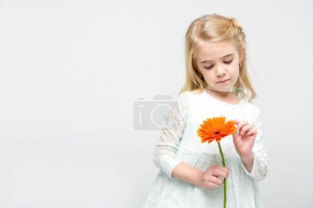 Girl with gerbera flower