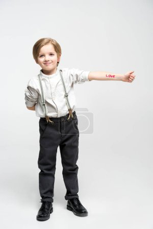 Little boy with word love