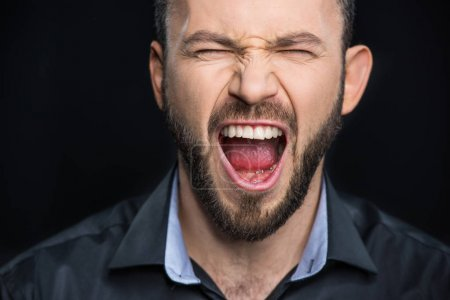Photo for Close-up portrait of bearded man screaming  isolated on black - Royalty Free Image